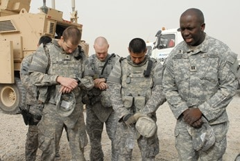 Soldiers Pray Before Mission