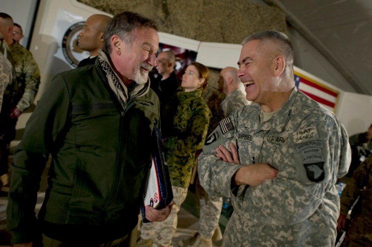 Comedian Robin Williams visits with Commanding General of Combined Task Force 101 U.S. Army Lt. Gen. John F. Campbell after the USO Holiday Tour show at Bagram Air Field, Afghanistan, on Dec.15, 2010. Photo credit: Petty Officer 1st Class Chad J. McNeeley, U.S. Navy (Public Domain)