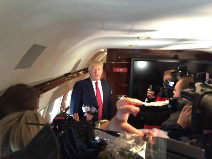 Trump gives a press conference aboard his plane back in April 2015 in Des Moines, IA.