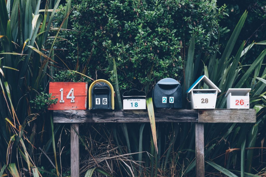 A photograph of a line of mailboxes