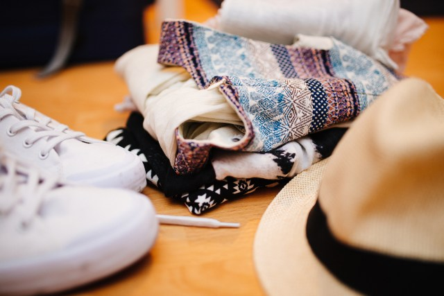 Packing to move abroad? You'll need to decide what clothes to bring. This and more tips at Caffeine and Roses