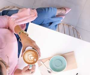 Pexels Photo - Woman in Pink Holding a Cup of Decorated Coffee