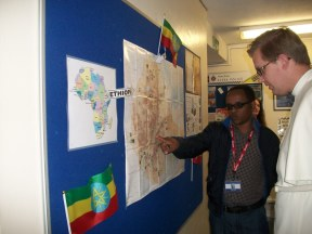 Tamiru looking at the lovely shcool display and showing Brother Gregory his home town.