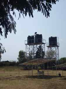 Overhead water tanks mounted by CAFOMI in Ntoroko
