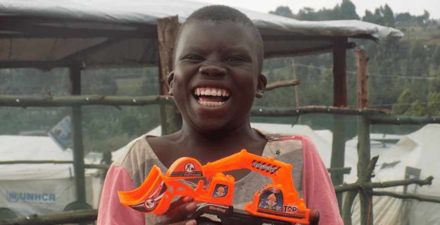 Instant-joy-after-receiving-a-toy-tractor,-Munguriek-couldn't-stop-smiling-after-receiving-his-new-toy
