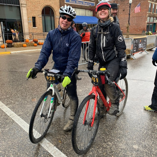 Two racers at the finish of the unsupported gravel race, The Filthy50 in Lanesboro, MN.