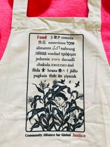 Close up of apron text: Nikki McClure poster art
