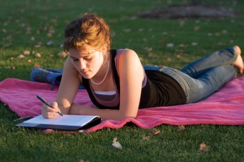 Casey studying on the quad