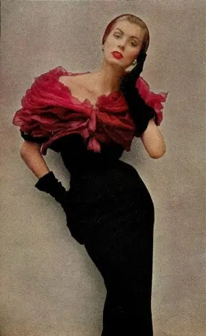 1952suzy parker in givenchy's deep red roses. a bolero of a thousand chiffon petals piled above a strip of black wool. darker than the roses, and velvet
