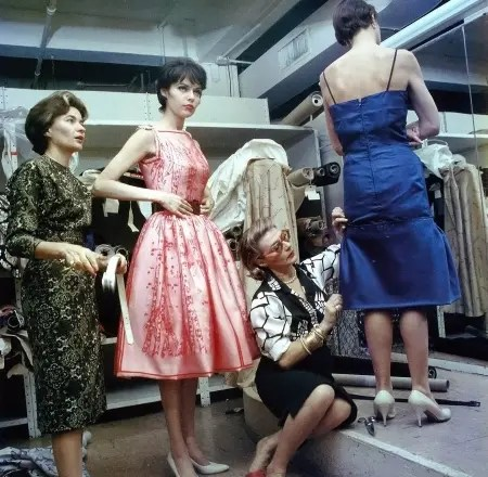 pauline-trigere-seated-fits-a-dress-on-a-model-while-giglis-wife-sue-ellen-tries-on-a-pink-dress-photo-by-ormond-gigli-1962