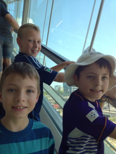 Riding the escalator with cousins.