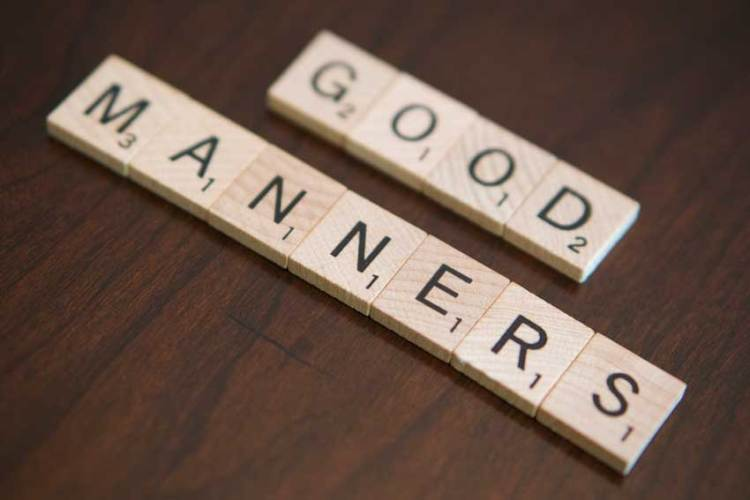 "Scrabble tiles spelling out ""good manners"""