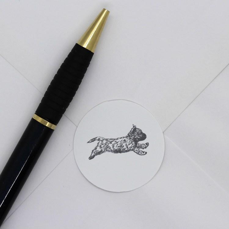 Cairn Terrier sticker sealing an envelope