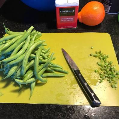 Cutting off stems of green beans