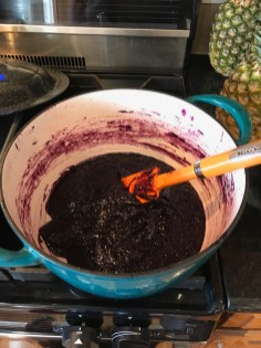 Stirring Blueberry Butter in dutch oven to thicken