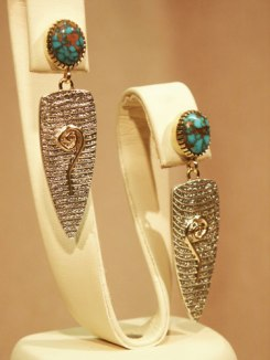 Cuttlebone Cast Sterling with Red Web Candelaria Turquoise 18K bezel and accents, post earrings