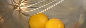 Egg yolks in the bowl image