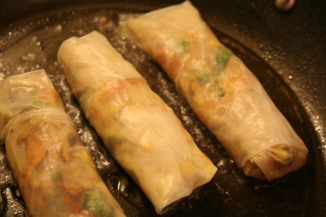 Pan steaming the spring rolls