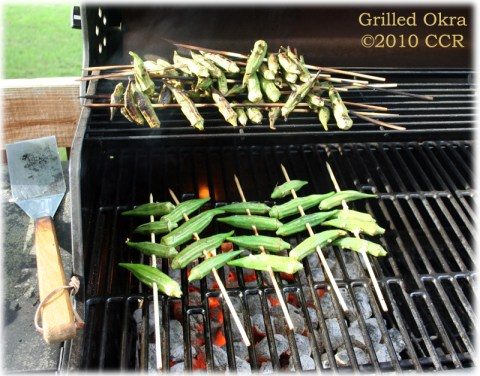 Grilling Okra on the coals, a few done at the top