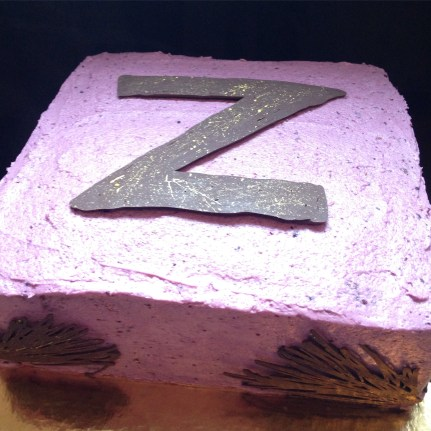 Chocolate berry cake with a chocolate Z