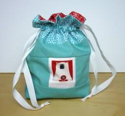 Lined drawstring bag with bear polaroid