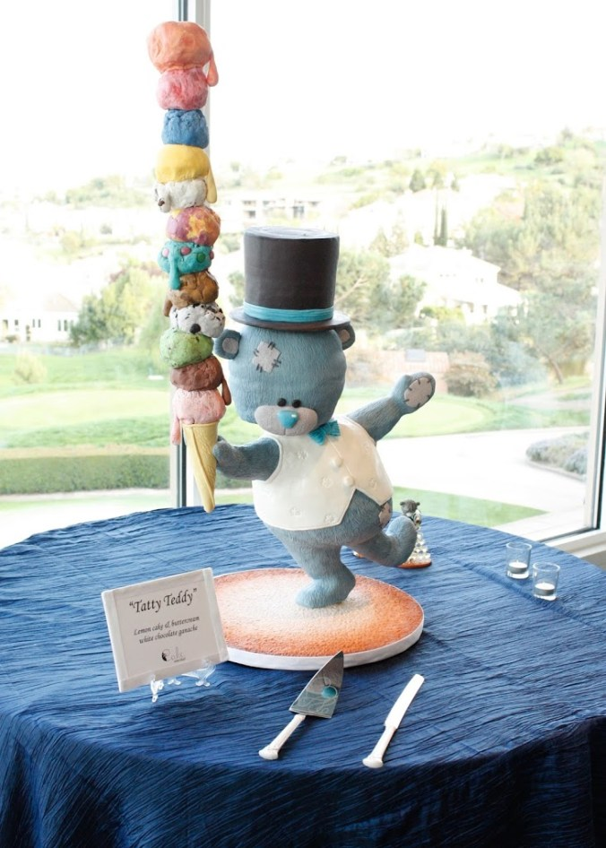 Gravity defying sculpted teddy bear wedding cake with giant ice cream cone