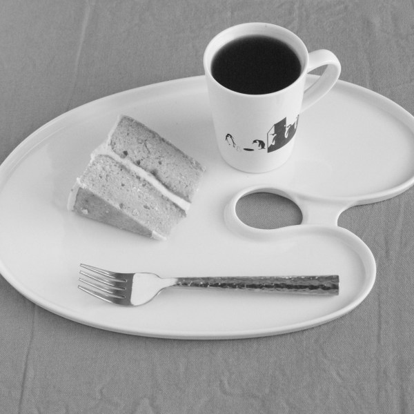 Cake and coffee on palate plate black and white
