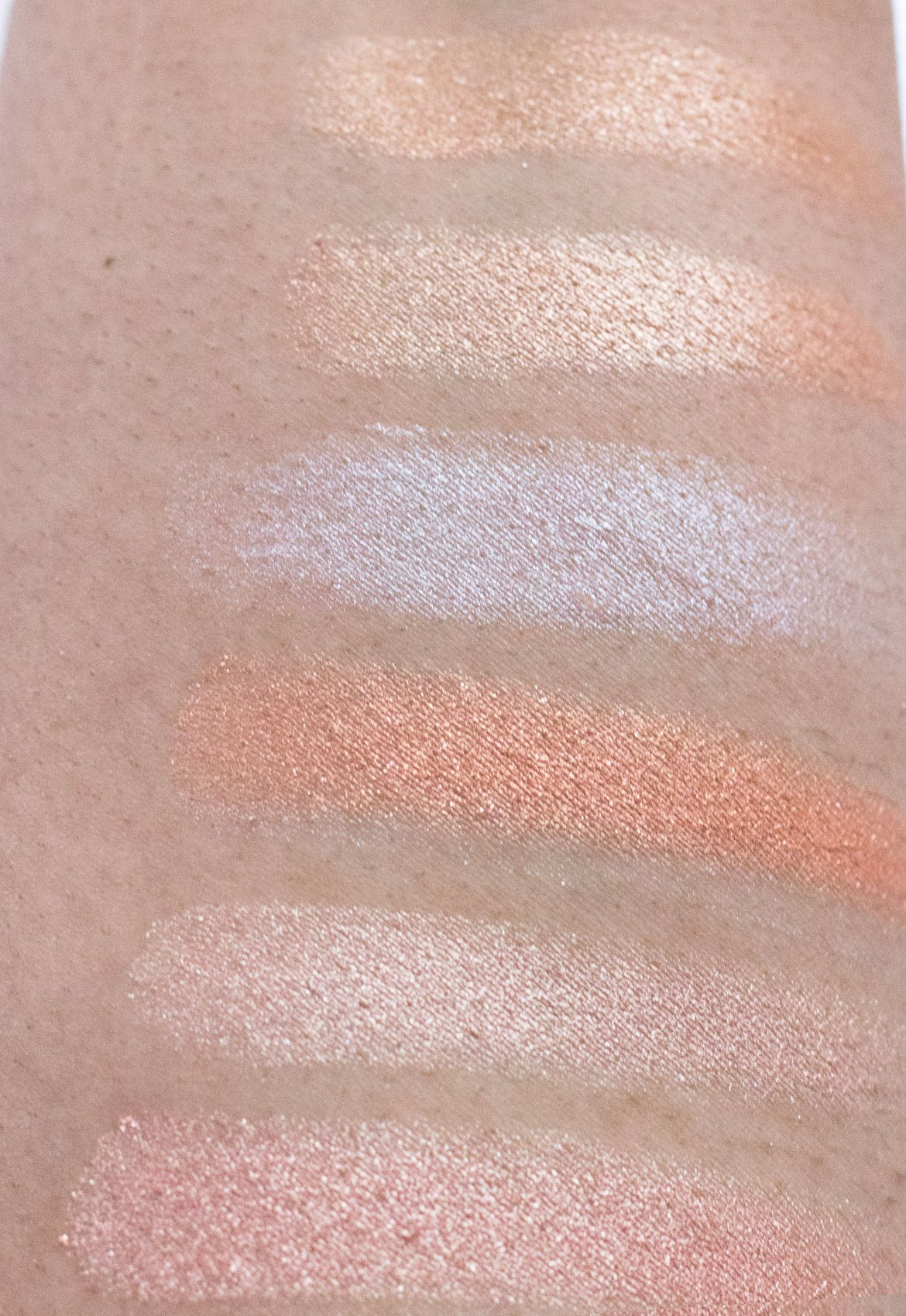 ABH Nicole Guerriero Glow Kit swatches top to bottom: 143, Glo Getter, Forever Lit, Daydream, Forever Young, Kitty Kat