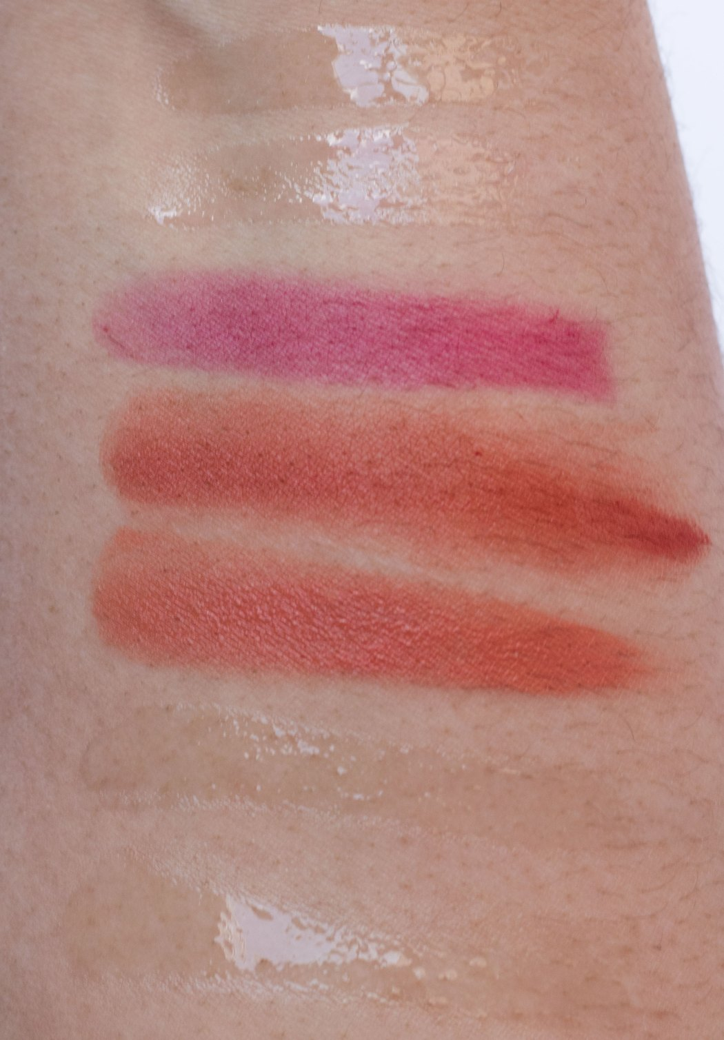 Swatches top to bottom: Glossier Lip Gloss, Dior Lip Maximizer, Glossier Gen G lipstick in Crush, Noto Botanics tint, Herbivore Botanicals Coco Rose Lip Tint, Kopari Coconut Lip Love, Complex Beauty Pout Protector vanilla lip mask