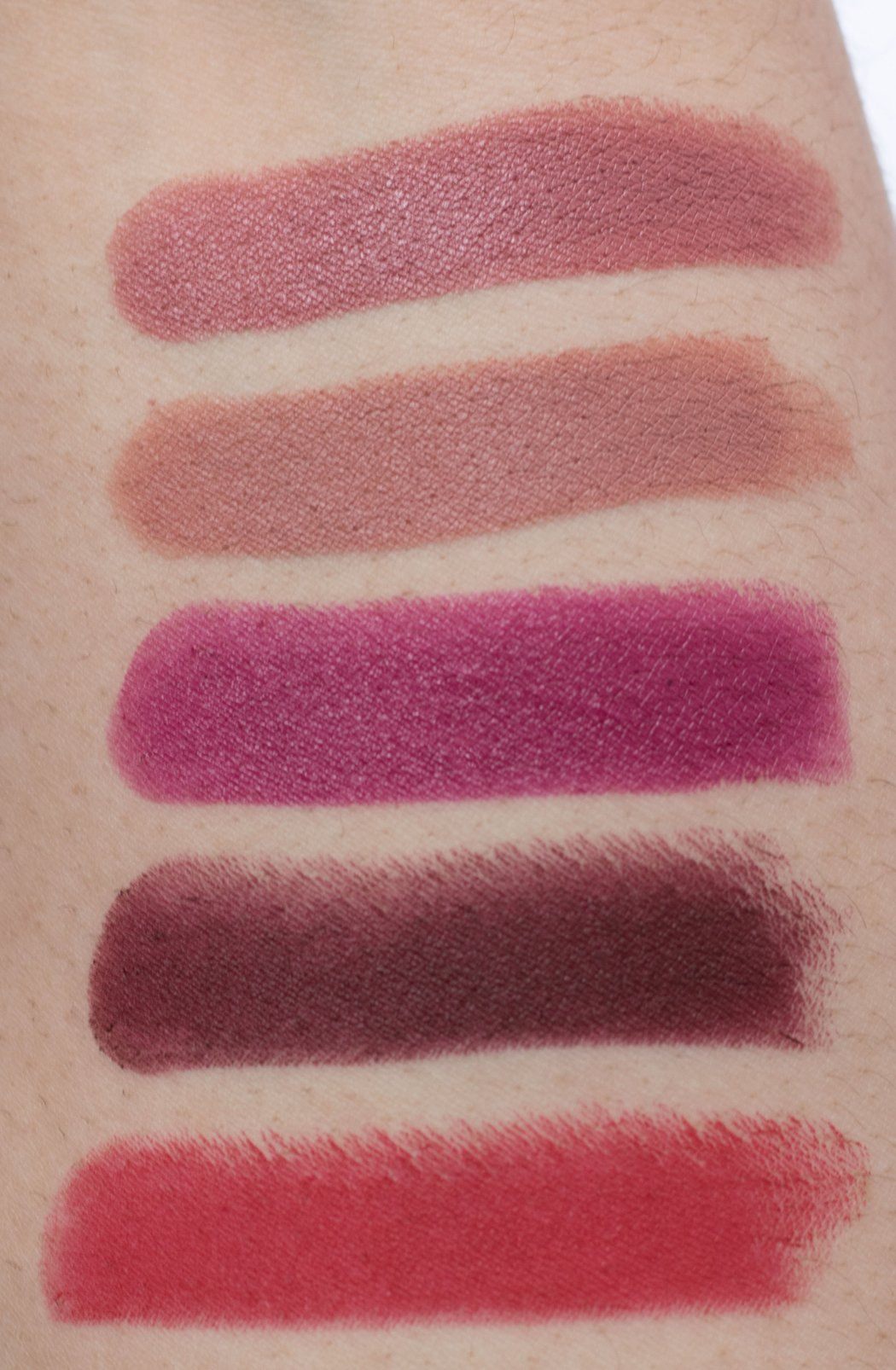 top to bottom: MAC Twig, Velvet Teddy, Rebel, Sin, Ruby Woo