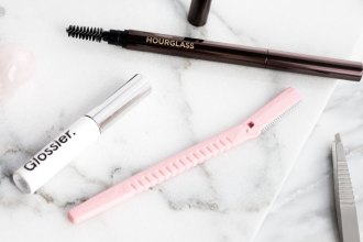 All the eyebrow products: Glossier Boy Brow, Hourglass Arch Brow Sculpting Pencil, tweezers