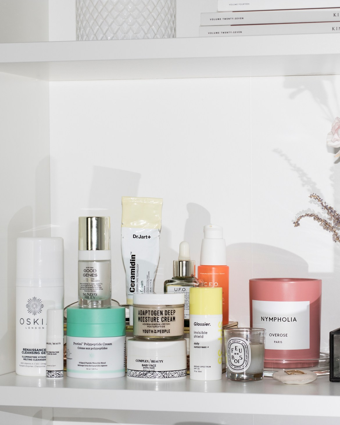 skincare shelfie featuring drunk elephant protini, glossier spf, YTTP adaptogen cream, and more