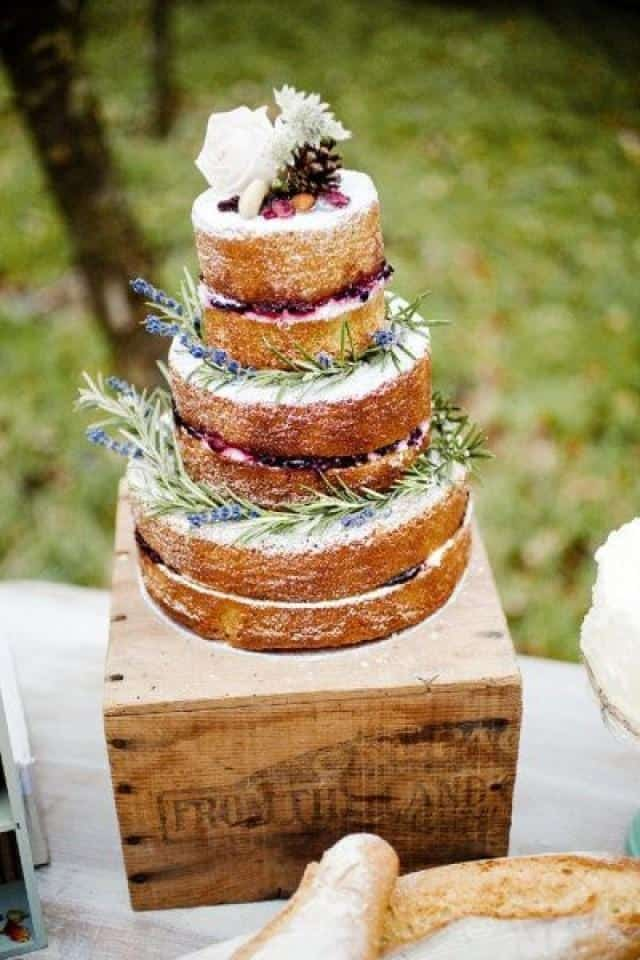 Rustic Wedding Cake with Flower, leaf, and pine cones topping