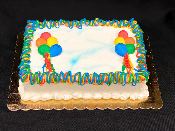 Frosted cake with balloons