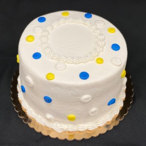 Round frosted cake with polka dots