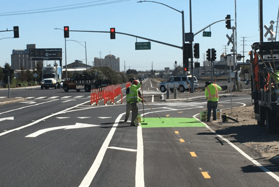 Applying the green on 9th Street at Woodland Avenue.