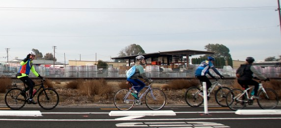 Stanislaus County Bicycle Club members ride down the curb-protected, two-way bike lane that connects the two campuses of Modesto Junior College. Photo: Minerva Perez