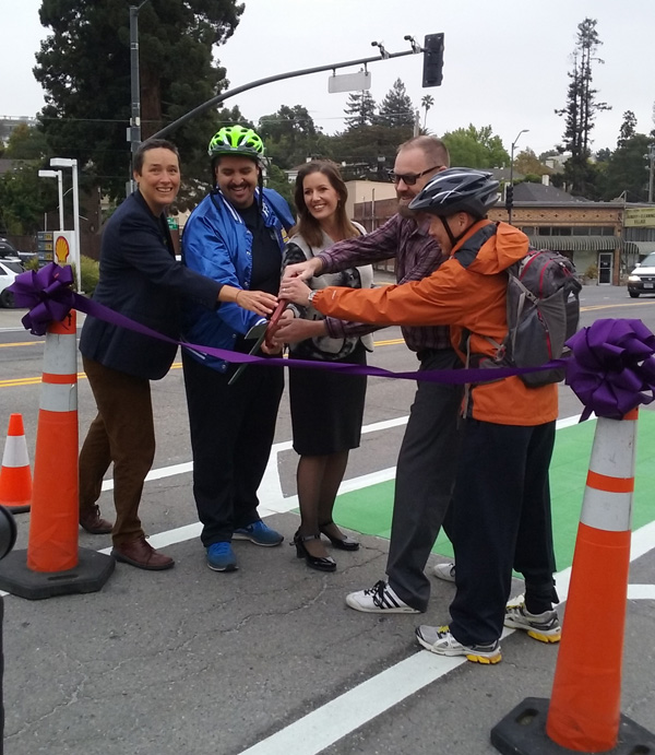 Another city, another ribbon to cut: Bike East Bay executive director Renee Rivera, on the left, joins Oakland City Councilmember Abel Guillen, Oakland Mayor Libby Schaaf, and Piedmont councilmembers Tim Rood and John Chang to officially open bike lanes on Grand Avenue connecting Oakland and PIedmont. Photo: Chris Hwang, WOBO