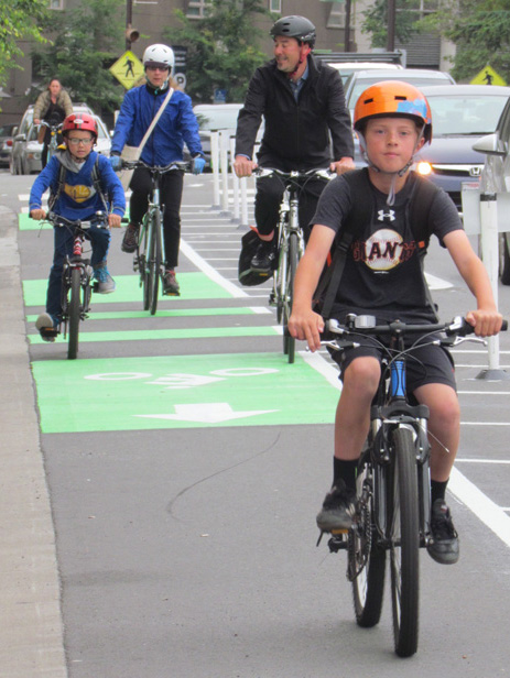 """This family rides Fulton Street to school every day. """"This wasn't here yesterday!"""" said mom, with delight. Photo: Melanie Curry/Streetsblog"""