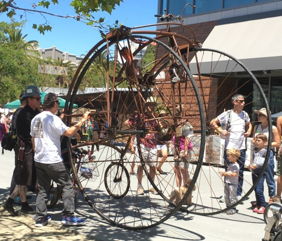 A giant quadricycle penny farthing.