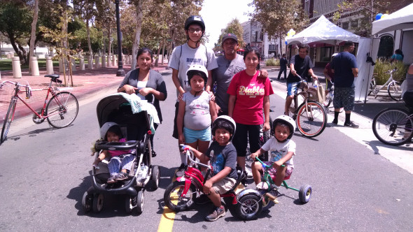 Jesus Rodriguez, 35, and his family at Santa Ana's 5k/Ciclovia. Rodriguez said he learned about the event through a City sponsored parent's group he's a part of. Photo by Kristopher Fortin.