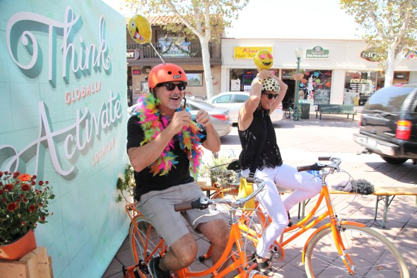 Two people hop on stationary bikes at North Orange County's (Park)ing Day. Photo by Kristopher Fortin