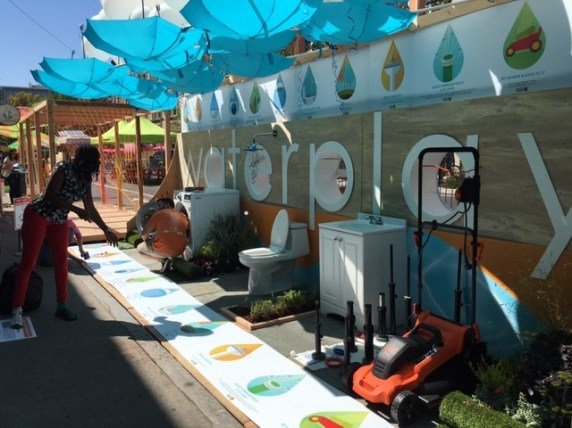 This booth in Sacramento combined water education with games, including one that required a very high level of skill and patience: throwing ping pong balls into a toilet. Photo: Melanie Curry/Streetsblog