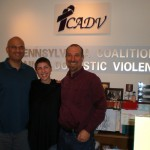 Chad Sniffen and David Lee with Casey Keene of VAWnet at the Pennsylvania Coalition Against Domestic Violence