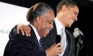 Senator Barack Obama laughs with Rev. Al Sharpton when sharptons cell phone went off on the podium during Obama's Speech at the National Action Network's Annual Convention at the Sheraton in Midton Manhattan Saturday morning. The speech was the last in Rev. Al Sharpton's series of Presidential Candidate speeches at the conference. It Was Sharpton's wife on the phone. Original Filename: JG4L0160.jpg