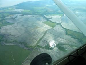 flooded fields below us