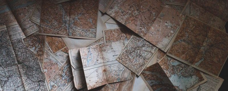 Some old maps spread across a table