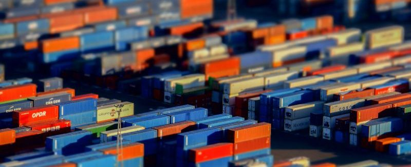 A zoomed out image of a shipping yard full of shipping containers