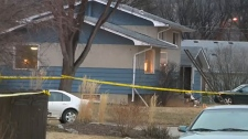 Police tape around a home
