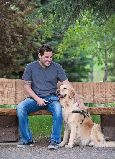 blind_man_sitting_with_happy_guide_dog